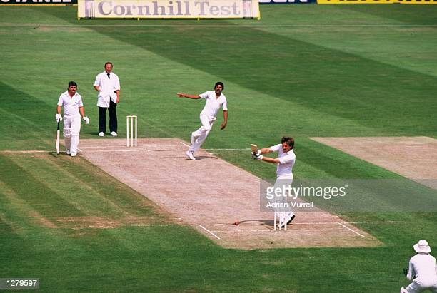 Ian Botham of England hits a ball from Kapil Dev of India during his 208 run innings in the Third Test at the Oval in London The match ended in a...