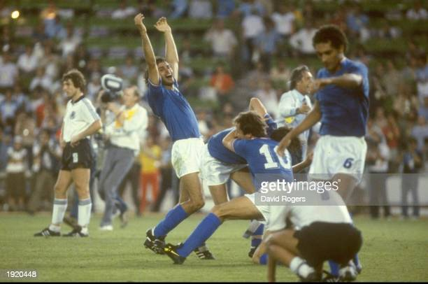 Italian players celebrate after their victory in the World Cup final against West Germany at the Bernabeu Stadium in Madrid Spain Italy won the match...