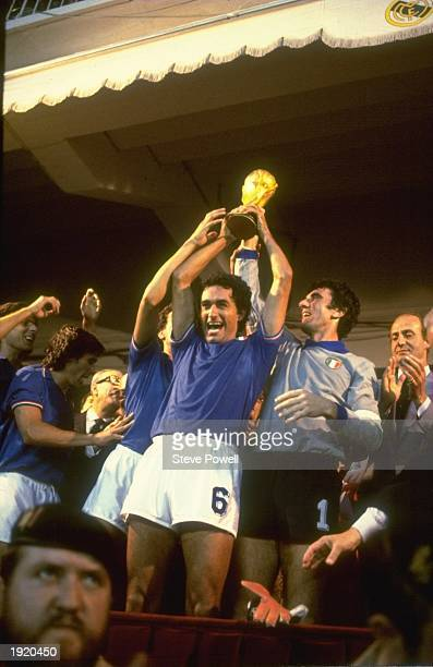 Scirea and Dino Zoff of Italy hold the trophy aloft after the World Cup final against West Germany at the Bernabeu Stadium in Madrid Spain Italy won...