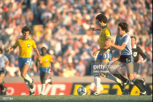 Socrates of Brazil kicks the ball during the World Cup match against Argentina in Barcelona Spain Brazil won the match 31 Mandatory Credit Allsport...