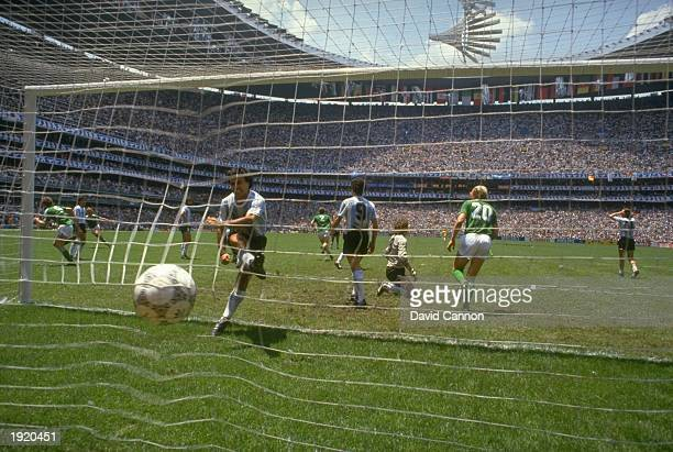 An Argentinian player kicks the ball in frustration after Rudi Voller scores West Germany's second goal during the World Cup final at the Azteca...