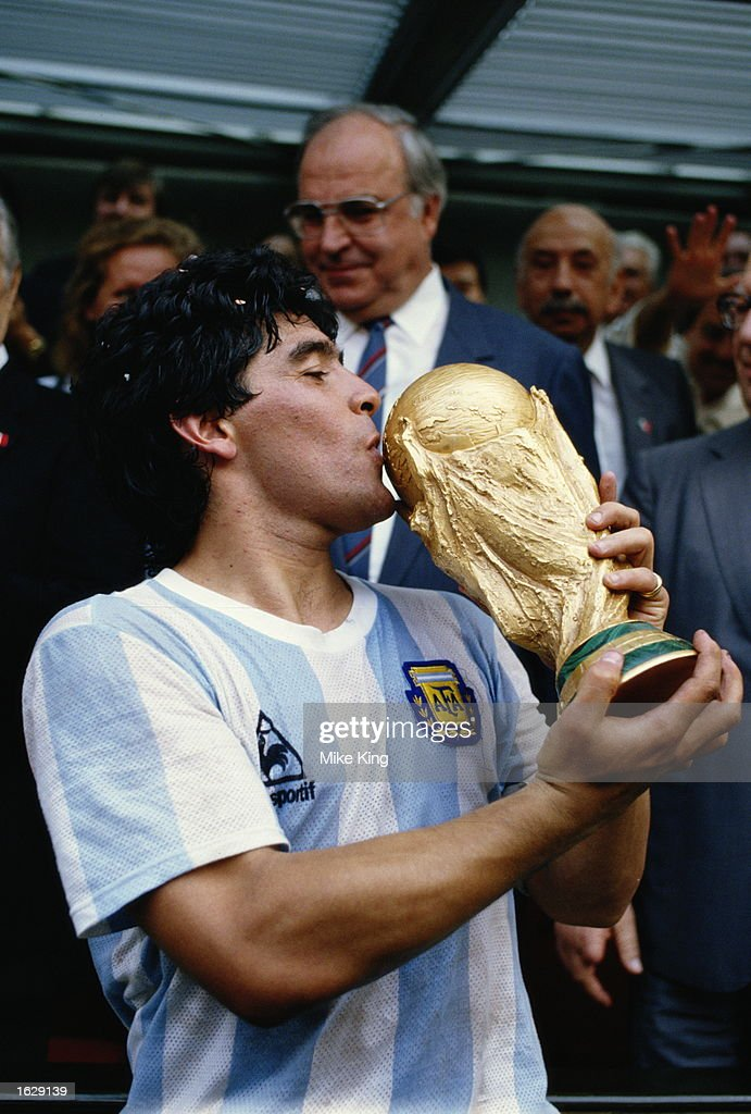 <a gi-track='captionPersonalityLinkClicked' href=/galleries/search?phrase=Diego+Maradona&family=editorial&specificpeople=210535 ng-click='$event.stopPropagation()'>Diego Maradona</a> of Argentina kisses the trophy after the World Cup final against West Germany at the Azteca Stadium in Mexico City. Argentina won the match 3-2. \ Mandatory Credit: Mike King/Allsport