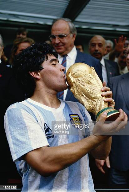 Diego Maradona of Argentina kisses the trophy after the World Cup final against West Germany at the Azteca Stadium in Mexico City Argentina won the...