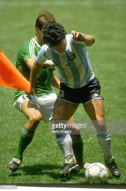Diego Maradona of Argentina takes on Thomas Berthold of West Germany during the World Cup final at the Azteca Stadium in Mexico City Argentina won...