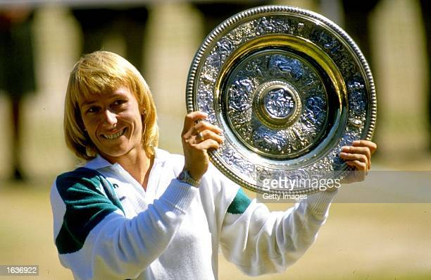 Martina Navratilova of the USA holds up the winner plate after winning the Wimbledon Championships played at Wimbledon London England Mandatory...