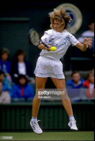 Steffi Graf of Germany plays a forehand return during the 1988 Wimbledon Championships held at the All England Club in Wimbledon England Mandatory...