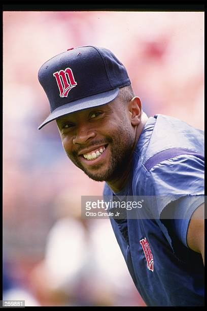 Outfielder Kirby Puckett of the Minnesota Twins smiles at the camera during a game against the Oakland Athletics at Oakland Alameda County Coliseum...