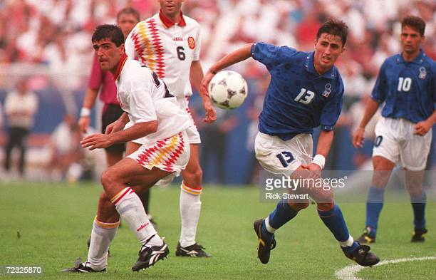 Dino Baggio of Italy battles Miguel Angel Nadal of Spain during their Quarter Final match in the 1994 World Cup at Foxboro Stadium Foxboro...