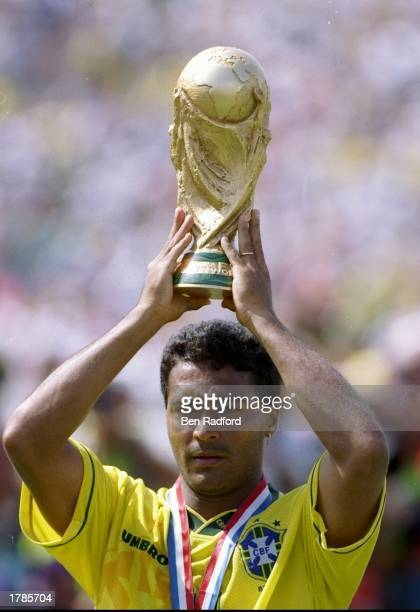 Romario of Brazil holds the World Cup trophy after winning a playoff game against Italy at the Rose Bowl in Pasadena California Brazil won the game...
