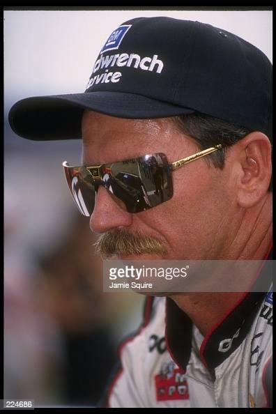 Dale Earnhardt looks on during the qualifying heats for the NASCAR Diehard 500 at Talladega Superspeedway in Talladega Alabama Mandatory Credit Jamie...