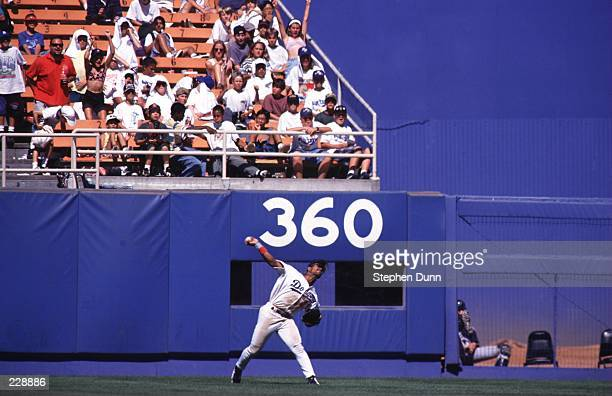 Right fielder Raul Mondesi of the Los Angeles Dodgers sets his feet to throw the ball during the Dodgers 65 victory over the Houston Astros at Dodger...