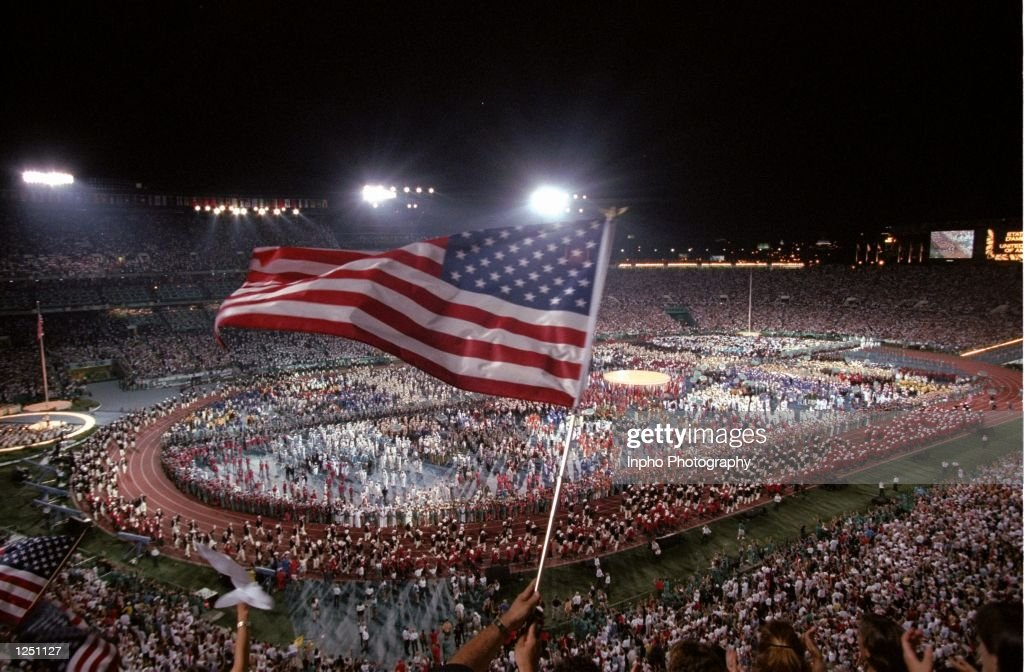 An AMerican flag is waved during the Opening Ceremony of the 1996 Centennial Olympic Games at the Olympic Stadium in Atlanta Georgia Mandatory Credit...