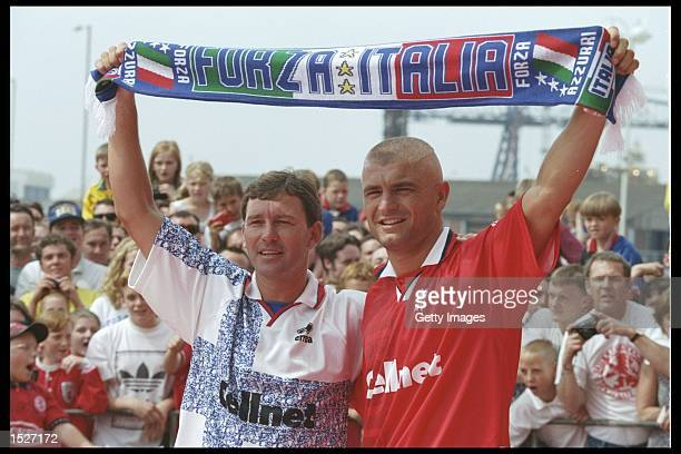 Bryan Robson the manager of Middlesbrough with Fabrizio Ravanelli of Italy as he signs for Midllesbrough and is greeted by the home crowd at...