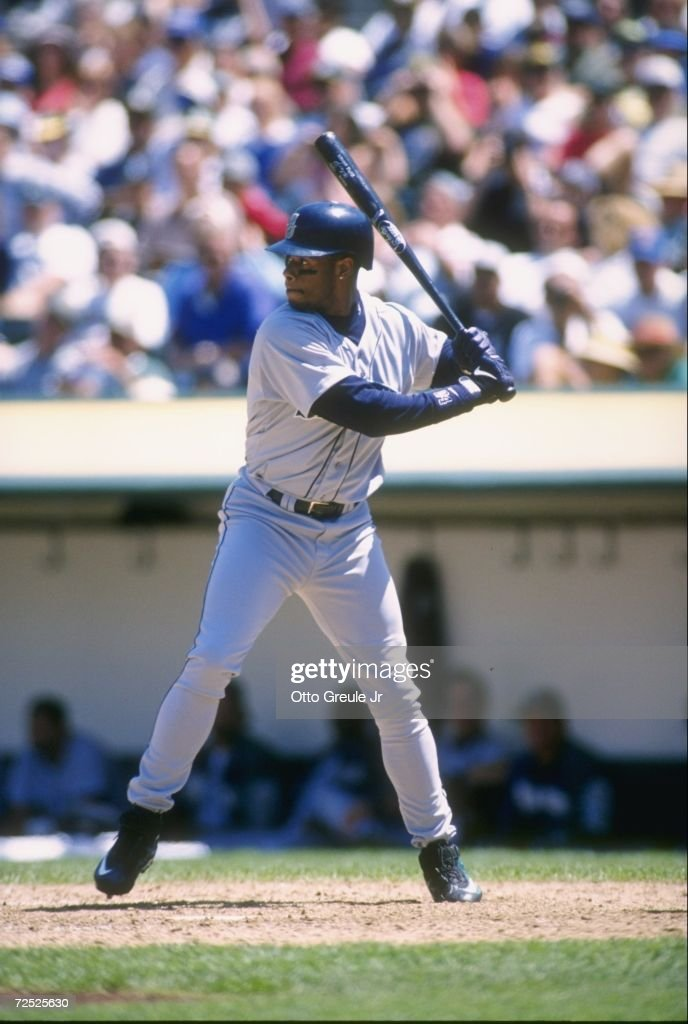Centerfielder <a gi-track='captionPersonalityLinkClicked' href=/galleries/search?phrase=Ken+Griffey+Jr.&family=editorial&specificpeople=171573 ng-click='$event.stopPropagation()'>Ken Griffey Jr.</a> of the Seattle Mariners stares back at the pitchers mound as he awaits the delivery of a pitch during an at-bat in the Mariners 12-5 loss to the Oakland A's at the Alameda County Coliseum in Oakland, California.