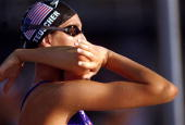 Cristina Teuscher of the USA stretches her arms before the Women 400m Freestyle Final during the 1996 Olympic Games at Georgia Tech Aquatic Center in...