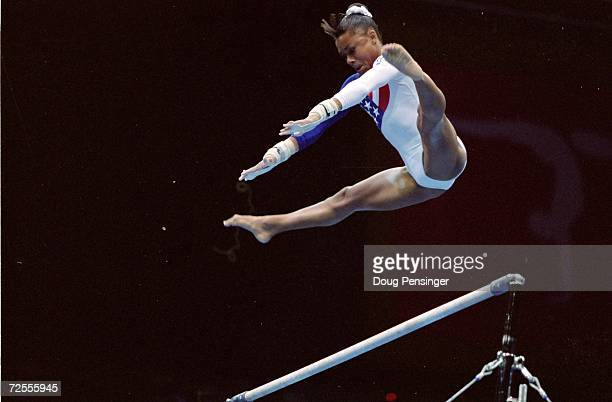 Dominique Dawes flys over the bar during her routine at the Georgia Dome in the 1996 Olympic Games in Atlanta Georgia Mandatory Credit Doug Pensinger...