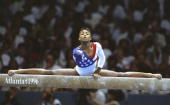 Dominique Dawes of the USA on the beam during the womens team gymnastics event at the Georgia Dome at the 1996 Centennial Olympic Games in Atlanta...