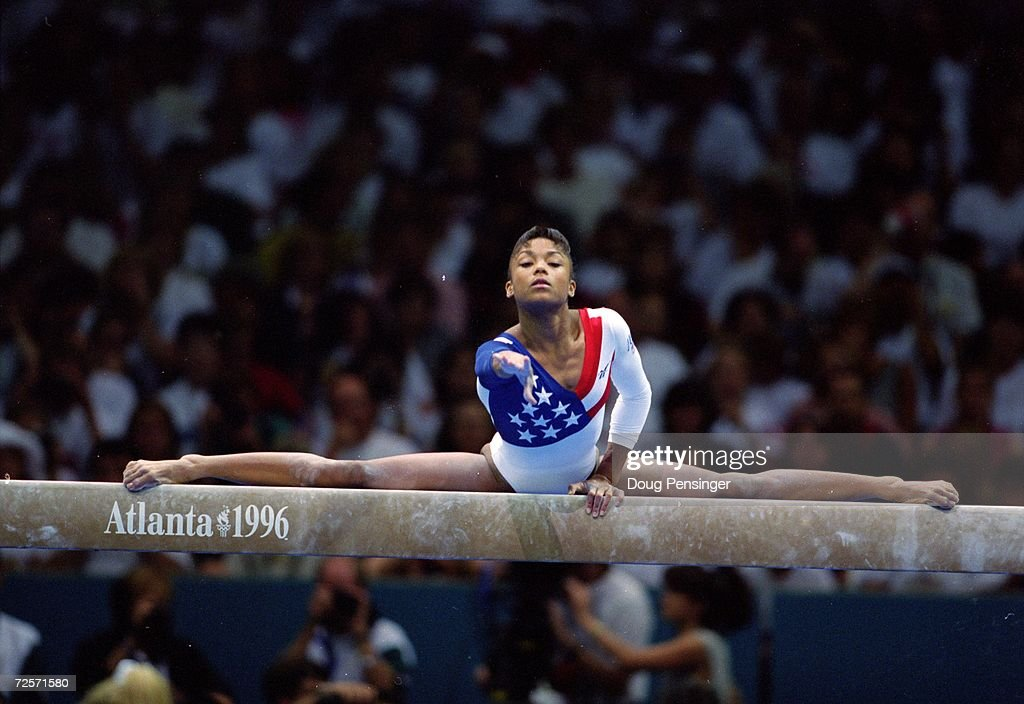 Dominique Dawes of the USA stretches on the balance beam during her routine at the Georgia Dome in the 1996 Olympic Games in Atlanta Georgia...