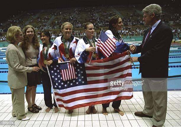 From left to right Hillary Clinton Chelsea Clinton Sheila Taormina Jenny Thompson Trina Jackson Christina Teuscher President Bill Clinton pose...