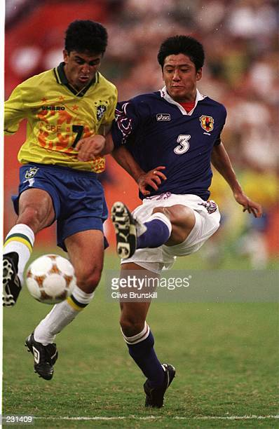 Hideto Suzuki of Japan battles with Bebeto of Brazil during his teams 10 victory tonight Brazil v Japan at the Orange Bowl Stadium Miami Florida USA...