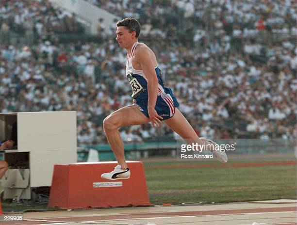 Jonathan Edwards of Great Britain performs his first jump during the triple jump finals at the 1996 Centennial Games inthe Olympic Stadium in Atlanta...