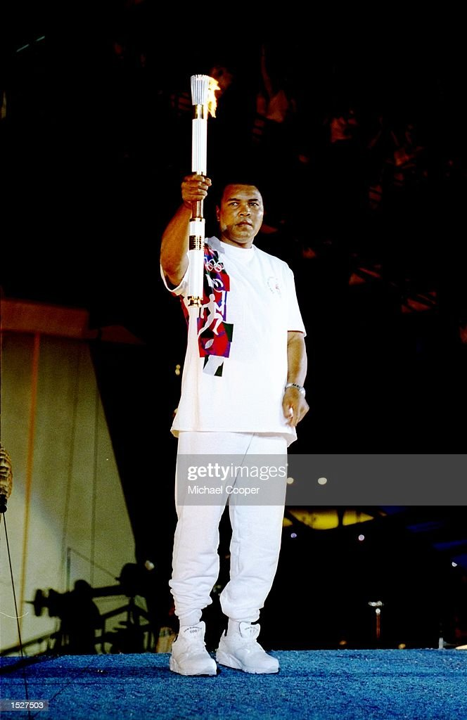 Muhammad Ali holds the torch before lighting the Olympic Flame during the Opening Ceremony of the 1996 Centennial Olympic Games in Atlanta Georgia...