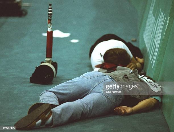 Photographers take a break from shooting during the table tennis event at the Georgia World Congress Center at the 1996 Centennial Olympic Games in...