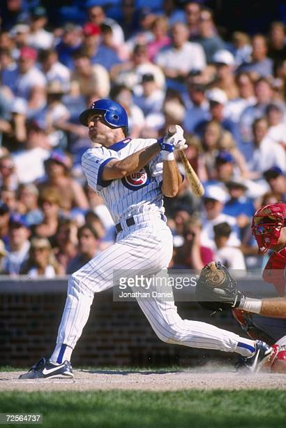 Second baseman Ryne Sandberg of the Chicago Cubs stares into the out field as he follows through on a swing following a hit in the Cubs 30 loss to...