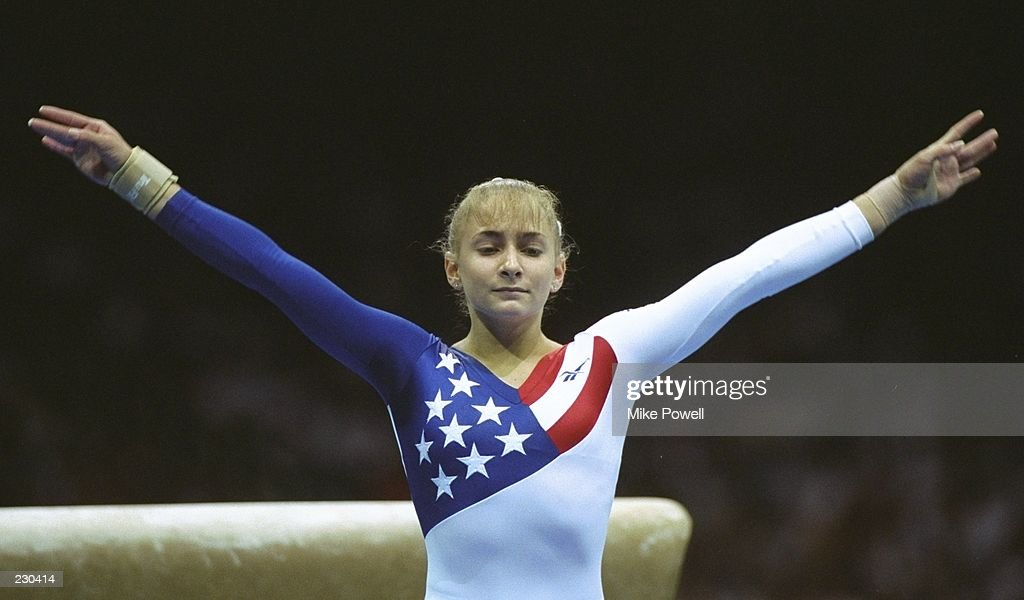Shannon Miller of the USA in action during the womens team gymnastics at the Georgia Dome at the 1996 Centennial Olympic Games in Atlanta Georgia...