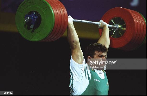 Stefan Botev of Bulgaria in action during the Second Heavyweight Weightlifting event at the 1996 Centennial Olympic Games at the World Congress...