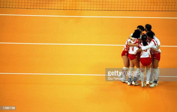 The Chinese team huddle during their Preliminary Pool Volleyball match against the Netherlands during the Centennial Olympic Games in Atlanta Georgia...
