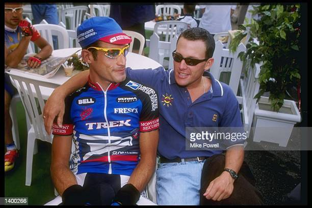 George Hincapie and Lance Armstrong of the United States look on during Stage Nine of the Tour de France between Pau and Loudenvielle France...