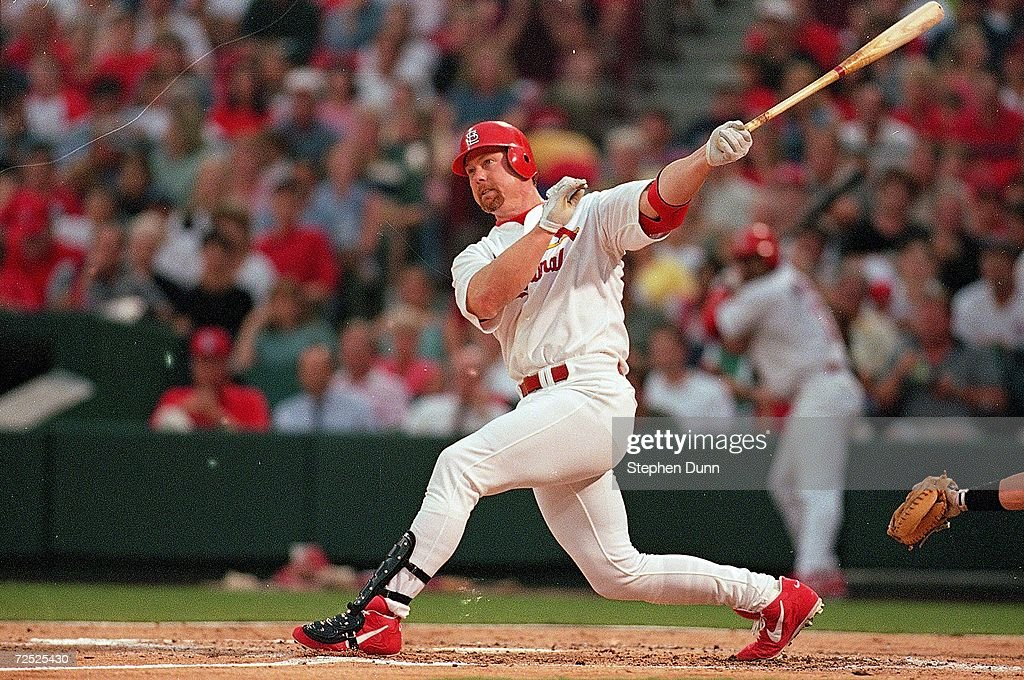Mark McGwire #25 of the St. Louis Cardinals hits the ball during the game against the Houston Astros at the Busch Stadium in St. Louis, Missouri. The Cardinals defeated the Astros 6-3. Mandatory Credit: Stephen Dunn /Allsport