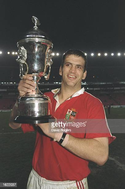 Martin Johnson the British Lions captain holds aloft the trophy after the third test match against South Africa at Ellis Park in Johannesburg South...