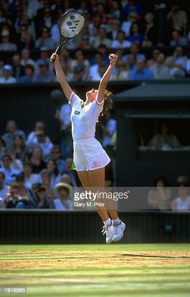 Martina Hingis of Switzerland raises her arms aloft and jumps for joy as she wins the Women's Singles final against Jana Novotna of the Czech...