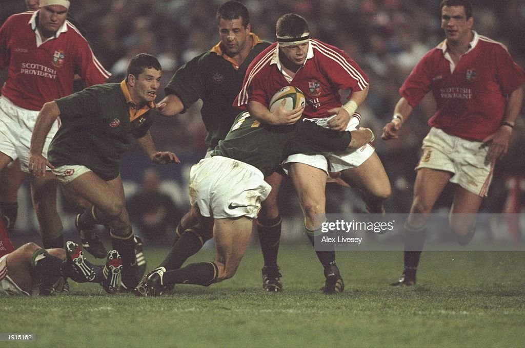 Paul Wallace of the British Lions powers through a tackle during the third test match against South Africa at Ellis Park in Johannesburg South Africa...