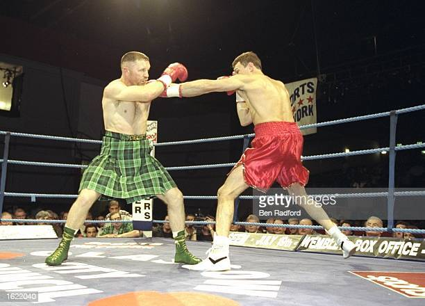 Steve Collins of Ireland blocks a punch from Craig Cummings of the USA during the WBO Super Middleweight Championship in Glasgow Scotland Collins...