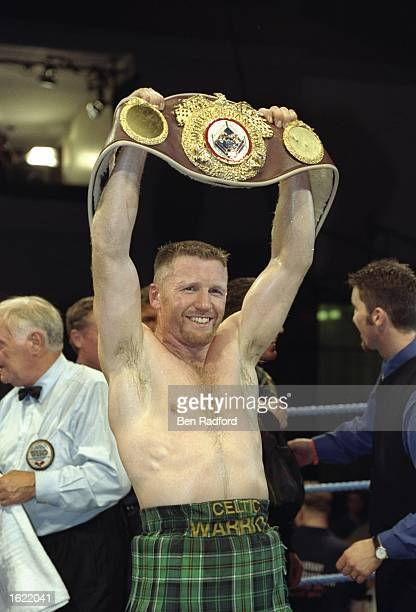 Steve Collins of Ireland holds aloft his WBO Super Middleweight belt after defeating Craig Cummings of the USA in Glasgow Scotland Collins retained...