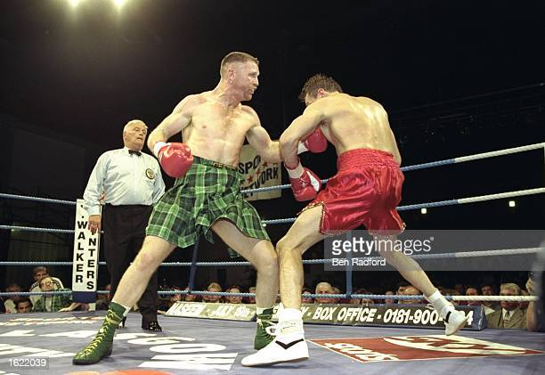 Steve Collins of Ireland throws a punch at Craig Cummings of the USA during the WBO Super Middleweight Championship in Glasgow Scotland Collins...