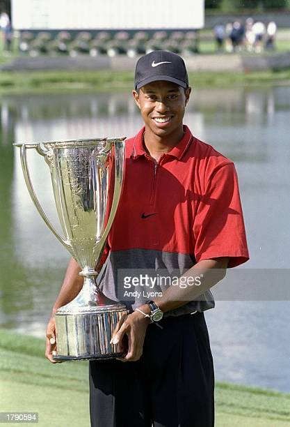 Tiger Woods smiles as he holds his trophy for the Motorola Western Open at the Cog Hill Country Club in Lemont Illinois Mandatory Credit Andy Lyons...