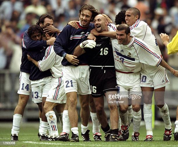 Alan Boghossian Bernard Diomede Bixente Lizarazu Christophe Dugarry Fabien Barthez Zinedine Zidane and David Trezeguet all of France celebrate after...