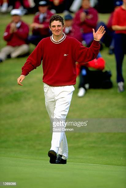 Amateur golfer Justin Rose of England acknowledges the crowd during the British Open at Royal Birkdale Golf Club in Lancashire England Rose won the...