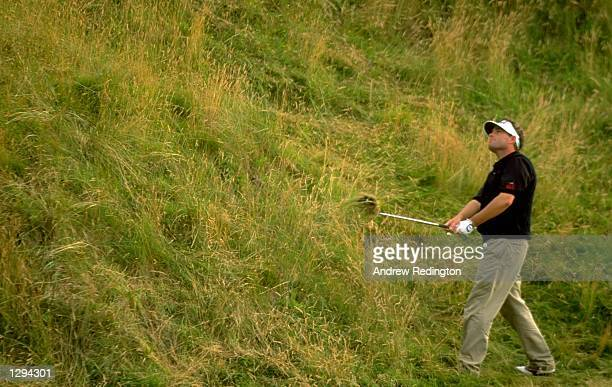 Brain Watts of the USA plays over a hill during the 1998 British Open held at Royal Birkdale Southport Merseyside England Mandatory Credit Andrew...
