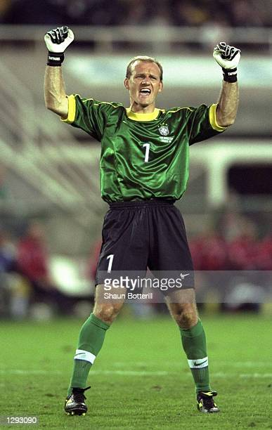 Claudio Taffarel of Brazil celebrates after victory in the World Cup quarterfinal match against Denmark at the Stade de la Beaujoire in Nantes France...