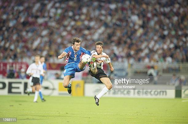 Davor Suker of Croatia and Lothar Matthaus of Germany stretch for the ball during the World Cup quarterfinal match at the Stade Gerland in Lyon...