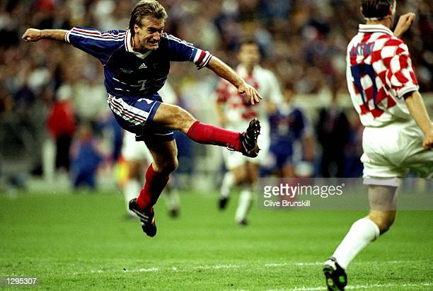 Didier Deschamps of France shoots at goal in the match between France v Croatia in the 1998 World Cup played in St Denis France Mandatory Credit...