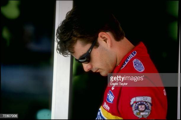 Driver Jeff Gordon looks down prior to the Jiffy Lube 300 at the New Hampshire International Speedway in Loudon New Hampshire Mandatory Credit David...