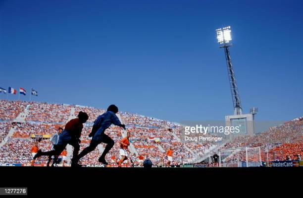 Edgar Davids of Holland shadows Ariel Ortega of Argentina during the World Cup quarterfinal at the Stade Velodrome in Marseilles Holland won the...
