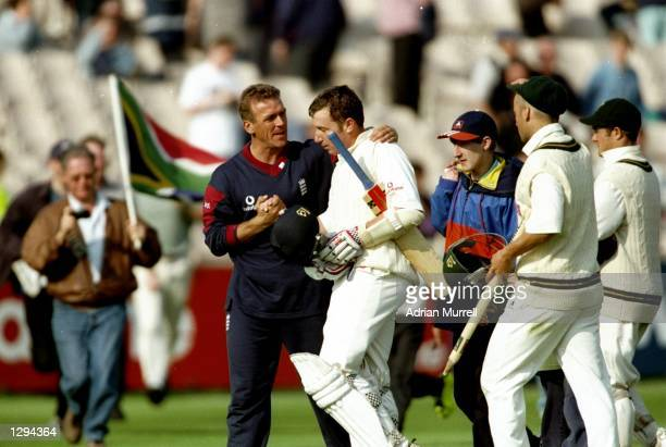 England Captain Alec Stewart congratulates team mate Robert Croft after the Third Test match against South Africa at Old Trafford in Manchester...