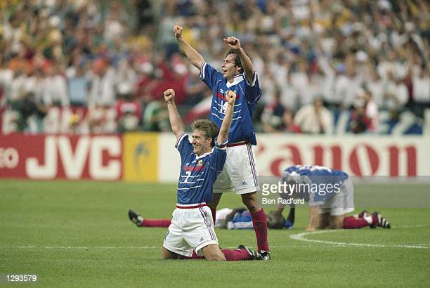 France captain Didier Deschamps and team mate Alain Boghossian punch the air in delight after victory in the World Cup Final against Brazil at the...